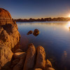 """Sunrise at Watson Lake, Prescott, Arizona<br /> One of my favorite spots to photograph in Arizona is the """"The Dells"""", Prescott, Arizona. The boulders are flung around  everywhere making some interesting fun photography. This sunrise shot was one of my 1st, before I started climbing and jumping around different boulders looking for better and better vantage points. I remember taking a leap between a rather deep crevasse and slammed my brand new Canon 16-35mm into the granite wall. It bounced back and slammed me in the nose giving me quite a jolt. The lens managed to stay in one piece, though the sky light filter got bent up pretty good. Saved by a cheap filter. That's the way to do it!"""