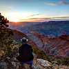 Grand Canyon Sunset overlooking Colorado River<br /> I imagine many Indians long ago squatted in this same spot, mesmerized by the grandeur of it all, gazing into this mother of canyons at sunset. It will take your breath away, hugging the vertical cliffs. With the wind whipping, you try to hold your ground..or else! Not a pleasant thought falling, but I'm sure it's happened. For me, I just stare into the sunset, with no care in the world. I came here to absorb this ancient place and take a few photographs. Mission accomplished.