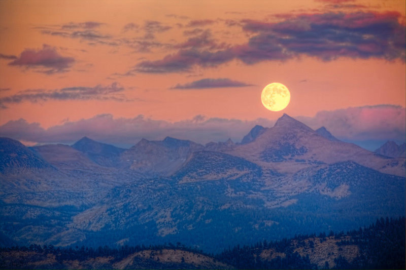 Full Moon at Glacier Point, Yosemite National Park<br /> A planned trip to Yosemite during Full Moon paid off this past September. The haze from forest fires lingering on the horizon. It was a beautiful calm night from Glacier Point, looking east across Grizzly Point. As it got dark, hikers coming down from Vernal Falls looked like lightning bugs scattered across the trails.