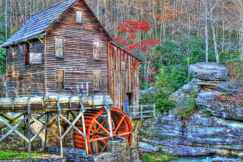 """""""Glade Creek Grist Mill""""- is located in Babcock State Park in West Virgina. I had seen photos of this location for years and always wanted to go there and take a shot at it. As always timing is everything. I had check when fall foliage was at it's peak and planned my trip. Just before leaving on any trip, I check the weather forecast. A big front was moving through with lots of rain and wind. I postponed my trip to go after the storm had passed. Got there and 40 mile an hour winds had blown 80% of the colorful autumn leaves off the trees. Who would have known. Got up early and did the best I could and I'll be sharing those photos."""