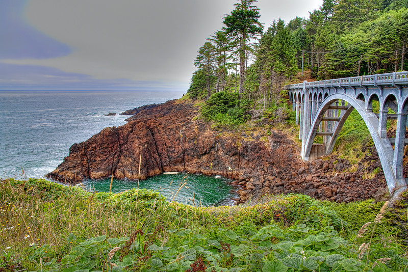 """""""Oregon Coast Bridge""""-Every year I make an effort to travel to Oregon to photograph the coast. Ever changing, ever beautiful. It's a great place to just slow down and enjoy nature's wonders. This part of Oregon's central coast is very rocky and makes for touching compositions."""