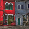 Colorful Burano, Italy-A short water taxi ride from Venice is an Island called Burano. For day trippers who want to get out of the hustle and bustle of Venice, Burano serves up a treat of pastel-hued homes all painted a different color, canals and bridges to stroll on and over, restaurants and gift shops, all the normal touristy things. As for photographers, you won't be disappointed. Your camera won't stop clicking.
