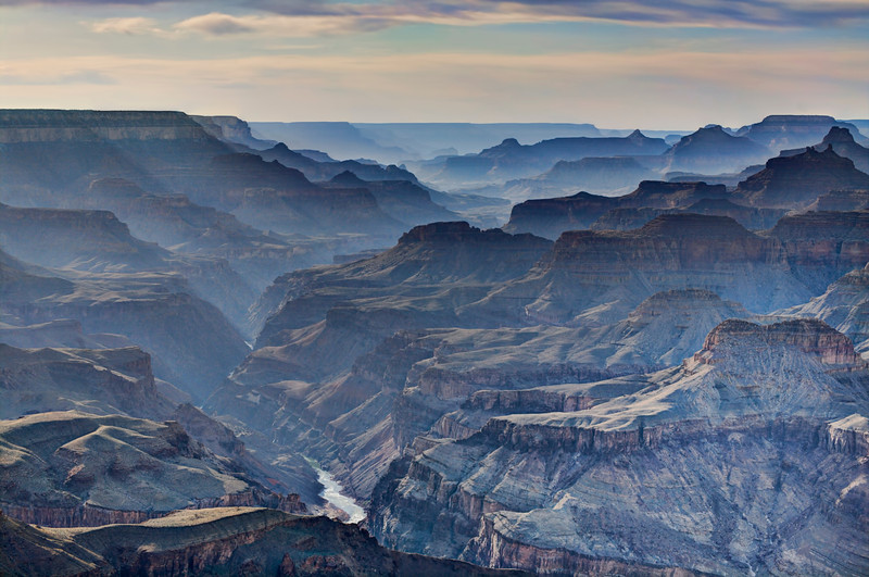 Smokey Sunset at The Grand Canyon, Az<br /> When I first saw all the smoke and haze hugging the Colorado River and canyon walls below, I didn't think much about photographing it. But the more I looked at it and the way the layers of canyons went off in the distance, maybe I can pull something out in HDR. With Photomatix, Topaz and a little Photoshop, it all came together and created it's own kind of mood. The Grand Canyon kind of does that to you anyway.