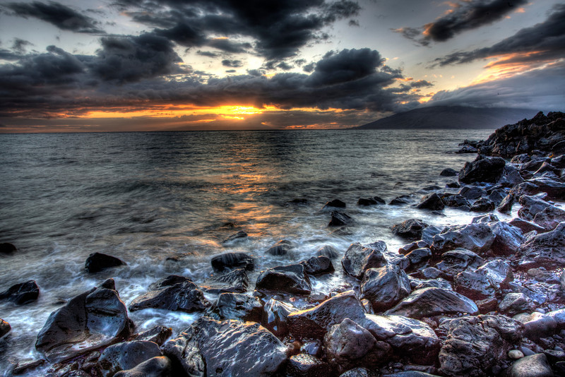 Sunset Over Molokai, Hawaii-Maui on the leeward side is a perfect area to catch great sunsets. We were in Kihue for these shots. Every night for 10 days it was scoping out the next great spot to catch magical colors as the light settled over the island of Molokai. Ths HDR shot was taken by merging 5 photos in Photomatix and then running it through Topaz Adjust and Photoshop CS5. Hope you enjoy!