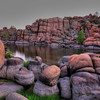 """""""The Dells""""-Prescott, Arizona- A peculiar kind of place. Looks like somewhere you would expect to see """"The Flintstones"""". Granite boulders just piled up everywhere. It's a blast just hiking and climbing and jumping around them, though my new wide angle Canon 16-35mm lens took a hit when I did a body ram into a wall on one of my crazy jumps. Good thing they're built tough, because it hit pretty hard. This was an after dusk shot when shadows were faded and winds had calmed down. Done with 3 exposures using Photomatix, Photoshopcs5 and Topaz Adjust"""
