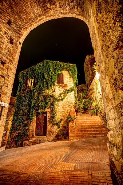 """Cobblestone Pathways in Siena, Italy<br /> On our many trips to Italy, this was our 1st trip up through Tuscany. As always we look for the backroads, that sometimes turns into dirt roads, that leads to dead ends. It's always fun getting lost. We carry a """"TomTom"""" to help us get back on track. In Siena, it's easy to get lost in the back alleyways, especially at night when one gets engulfed in taking pictures. I love long exposures and in this case multiple exposures to create HDR images."""