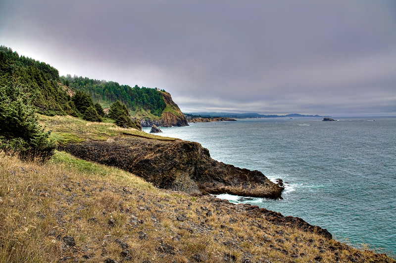 Coast near Lincoln City, Oregon<br /> Oregon Coast with it's fog and clouds never disappoints for a dramatic HDR shot. Summers are cool and we look for any excuse to get out of the Arizona heat and venture up to Oregon in summer to spend a week exploring the coast lines.