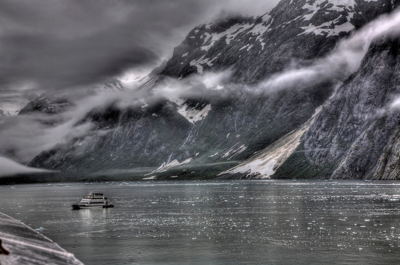 """Tour Boat at Margerie Glacier, Glacier Bay, Alaska<br /> Doesn't this look a bit frigid. Well it actually was. Pieces of ice float by the tour boat as it approaches Margerie Glacier off to the right. I decided to go with a black and white HDR photo, with a little green showing through. You can see photos of the Margerie Glacier under """"Categories"""", then """"Alaska"""". We were watching from a distance on the comfort of a Cruiseship. Though it wasn't that comfortable because it was raining at the time. Keeping the camera from the weather is always a challenge in circumstances like this. But you do what you can and just marvel at the majesty of it all. That is Alaska!"""