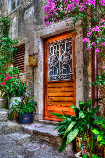 """""""Buy This Photo""""-""""Doors of Pride""""-Dubrovnik, Croatia-In Dubrovnik,Croatia, the many stairs within the old city walls lead to fancy doors. The centurys-old homes outlived the well-kept doors showing pride of ownership. As steep as the corridors of stairs were, I would walk up and down each one searching for the fanciest ones. Quite winded most of the time, I knew the entryways would make great HDR photos. Hope you agree."""