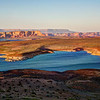 Lake Powell, Arizona<br /> Lake Powell is one of those kind of lakes you could spend a life time exploring. I've done a fair share of exploring, boating, fishing, skiing, hiking, camping, scout outings, performing at the Wahweep Resort, 4th of July's watching fireworks over Glen Canyon Dam, houseboating, jumping off cliffs, getting lost, and yes, even photographing this marvelous place. This Vista shot is just north Glen Canyon Dam at sunset.