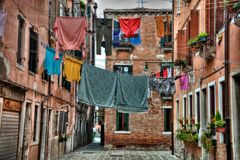 """""""Hanging Out To Dry, Venice""""-In Venice, it's pretty common on the back streets to see folks hanging it all out to dry; work clothes,underwear, lingerie. On a pulley system, the rope rolls it in and rolls it out. I think at home if you let your under garments hang out to dry, for all to see, you might get arrested, or at least laughed at. Makes for an interesting shot. Lacking the space, all things modern haven't quite hit the back streets of Venice. Still one of my favorites places to go."""