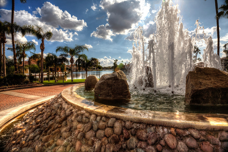 """""""Three Coins In The Fountain""""-One of my first photos of HDR, practicing in my own neighborhood here in Arizona. I happen to live in a lake community in the Phoenix area and a fountain with water is a natural draw for HDR shots. Their's nothing natural about a lake in the desert, so man-made is as good as it gets. It's humbling to think of a lake in such a dry and arid place, and sometimes the luxury of it all seems a little silly."""