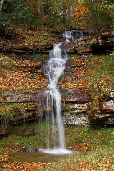 West Virginia Wandering Cascades<br /> Autumn this year was blazing colorful in West Virgina, but they had such a dry season , one could hardly find any nice waterfalls. So I dug through my arsenal of photos from my last trip and found this beautiful cascade, which has no name, that I could find. It just happened to be on a country back road, just waiting for me to find. It was completely gone this year, so I reminisce.