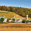 """""""Farms of Lancaster County, Pa""""-Anytime we are near Philly, we try to get over to Lancaster County and drive the back roads. The Amish and Mennonite farms are spread out everywhere. They take such care in maintaining their properties, so us tourist can take beautiful pictures. I'm sure that's not their reason, but I do encourage you to get off the Interstate, slow down and see what life was like 100 years ago. Stop at the roadside farmer's markets and get some homemade rootbeer. Autumn is the best time to visit. Pick up a map that shows where all the covered bridges are and take the tour around the county checking them out."""