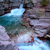 """""""St Mary Falls, Glacier National Park""""-It was getting near sunset and I had my doubts about trekking on a 1 mile hike out to St Mary Falls, alone. This is Wyoming, wild bear country and I have a fear about bears. I've run into them face-to-face before, seen them on many trails and I'm not fond of it. I never ventured out this late in the day, but I knew this would be the perfect time to catch a good shot of the falls. An Asian couple was speeding by me and I ask if I could tag along. We made it to the falls in record time. They wanted to snap a quick picture and head back. I convinced them to hang out for a little while so Buy a Print of this Photo-St Mary Falls,Glacier National Park-I could get my gear set up and snap a few different perspectives. They lasted for about 5 minutes and I did not want to be left behind, so I packed it in and we headed back. It doesn't take much to spook yourself when you're traveling alone. This stop was late in the season and they were closing Glacier National Park for the winter in just a few days. I was on a 6000 mile, two month journey to hit all the National Parks in the Northwest, including some in Canada. I kept moving south and autumn was coming in full bloom. I'll share some of those another time."""
