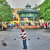 Lazy Days in Old San Juan, Puerto Rico-In old San Juan, families come out to sit in the square and watch their kids play, just like they would in a park somewhere. We stayed in a hotel overlooking the square, right in the heart of old San Juan. Most visitors usually end up staying in a resort on the beach, but this trip we wanted to be downtown, closer to the normal coming's and going's of the locals. I spent the day pretty much walking the entire town, trying to grab the local scene, the typical sites, and the off-the-beaten path kind of shots.<br /> <br /> We don't feed pigeons in Arizona. Most people treat them like pest here and would just as soon eradicate them. I live in a rare community in Arizona that is surrounded by water, so we have a lot of them hanging out. I won't  be feeding any pigeons. Neighbors don't take kind to that. So we hop on a plane and go to Venice or Puerto Rico or somewhere where they are treated like nice pest and through out some bird seed.
