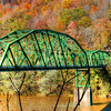 Bridge Under the New River Gorge Bridge<br /> Fall is a great time to take the winding dirt road into the River Gorge,West Virgina. Beautiful autumn colors light up the deep gorge. At the bottom you cross a bridge that leads you up to Wolf Creek. I spent a day just photographing this incredible valley.