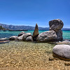 """Crystal Bay, Lake Tahoe, California<br /> We picked a great time to visit Lake Tahoe. In early June nobody was there. We were one of the only travelers in our hotel at Kings Beach. We drove around the whole lake and decided we liked the northern and eastern area for photos of sunsets and rock formations, such as the one found in the photo. It was down a path from a residential area that had public access. We found out that folks here don't take kindly to people trespassing on their property. They paid for the view and they want it all to """"themselves""""!"""