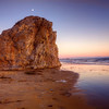 """Moon Over The Gold Nugget, Shell Beach, California<br /> The golden hues of the sunset on this giant rock or """"Sea Stack"""" of sorts, kind of reminded me of a huge """"gold nugget"""". I wander if there is one, somewhere buried deep in the earth, waiting to be found. One gold piece that size would make you rich as Bill Gates. I digress.<br /> <br /> This beautiful beach we stayed at this summer, is called Shell Beach, which is just north of the infamous party beach-Pismo Beach. We were there a few days before July 4th celebrations and from our room high on the cliffs of Shell Beach, we could watch the R.V's and campers clamouring through the sand dunes, looking to find a place on the beach to celebrate the 4th. Pismo Beach is one of the few beaches I know of, where you can drive right down on the beach and set up camp. Pretty cool idea.<br /> <br /> In 1971, while stationed at Vandenburg Air Base, I had the rare opportunity on Pismo Beach, to see the bioluminescence of phytoplankton, light up the waves and our footprints as we walked. I have never seen it since. I have heard, the Island of Viques, off Puerto Rico, has seen these little """"light up in the dark fish"""".<br /> <br /> More info on Photoplankton <a href=""""http://www.environmentalgraffiti.com/offbeat-news/introducing-natural-glow-in-the-dark-water/913"""">http://www.environmentalgraffiti.com/offbeat-news/introducing-natural-glow-in-the-dark-water/913</a>"""
