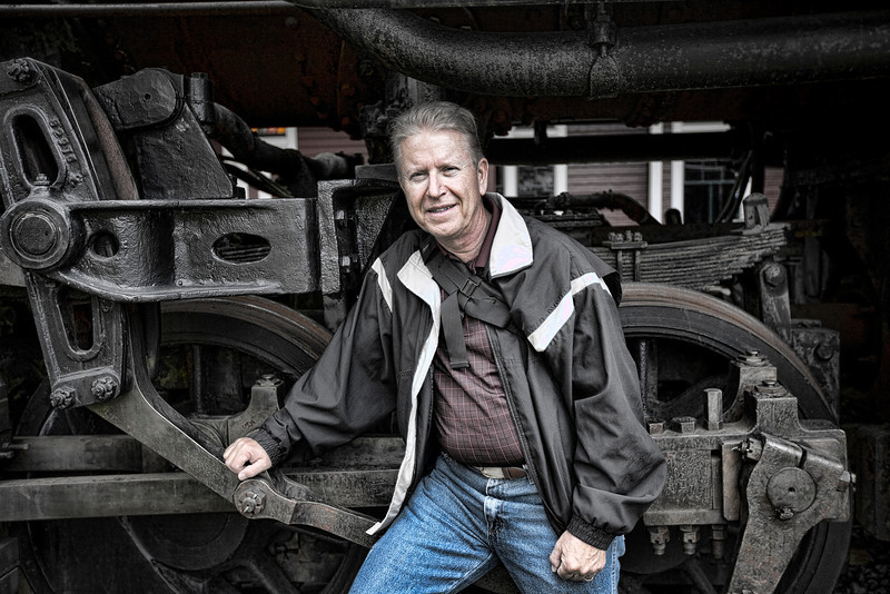 Dave posing in front of a locomotive at the Northwest Railway Station in Snoqualmie, Washington.