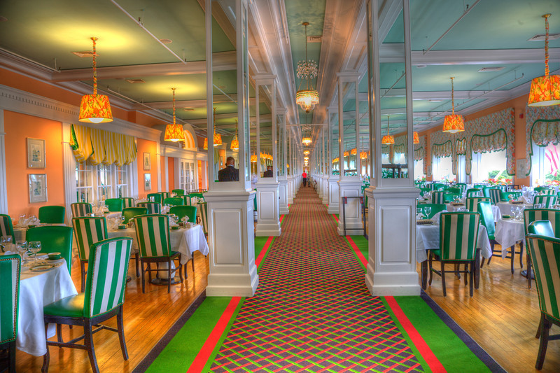 """Dining Room, Grand Hotel, Mackinac Island, Michigan<br /> The green just kind of overwhelms you, walking into this dining room. The hotel has a policy, if you want to explore the hotel, you pay a fee of $15.00 and you can roam, take pictures, enjoy a visit and check out photos of the movies that were filmed on location at the hotel. I thought it was worth it, not to be bugged for having a tripod and larger camera. They take it in stride and it really is a """"Grand Hotel"""" to visit. Staying there was kind of out of the budget. Photographers never sit still long enough to enjoy these kind of places."""