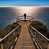 Muir Beach Overlook, California<br /> On a photo tour of San Francisco this past week, we managed to luck out with a few days of clear blue weather. We took a trip up through Muir Woods and along the coast and stumbled upon Muir Beach Overlook. My wife was standing at the overlook admiring the incredible view, so I thought I would photograph the incredible view..my wife.. that is!! Actually I ask her to pose for this silhouette  shot. It was amazing that we caught the sun reflecting directing toward the steps and that made the model (my wife) a truly amazing shot!