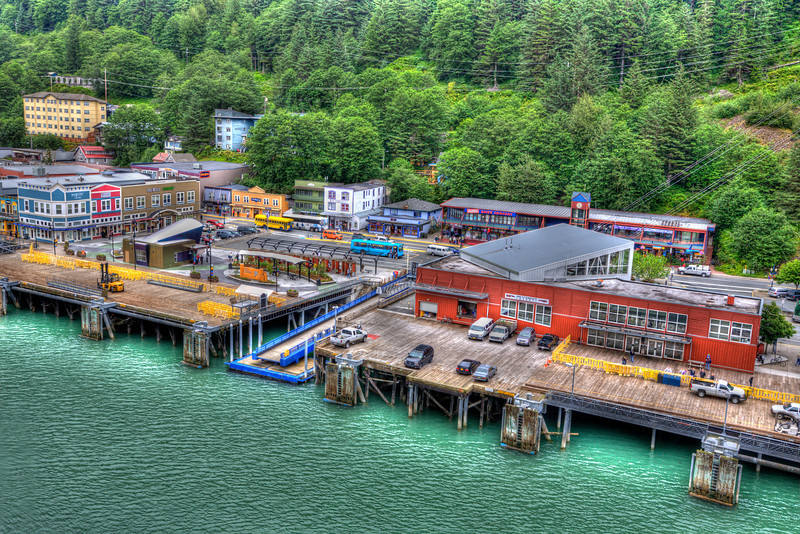 Cruise Ship Pier at Juneau, Alaska<br /> Pulling into Alaska's capital of Juneau almost looks make-believe from atop a cruise ship using a bit of HDR. It was raining and that made it fun and different for us Arizonians. We spent the day walking all over Juneau, with umbrellas and a nice steady rain. What more could you ask for. We don't get much of that in the desert, so it truly was a pleasant experience, soaked shoes and all.