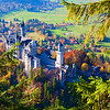 """Castle Neuschwanstein, Bavaria, Germany<br /> Ludwig II's fairy tale castle, as it is sometimes called is the climax to the """"Romantic Road"""" trip through southern Germany into Bavaria. Autumn was in full blaze when we arrived the evening before. Snow was forecasted to be moving in and the small town of Schwangau, we decided to stay in, was completely fogged in. The next morning of our planned trip to the """"fairy tale""""  castle didn't look to promising with everything still fogged in. I guess the weather gods heard our cry for clear passage, for by noon the skies had cleared into a beautiful blue day, which allowed us to hike higher into the mountains above the castle and catch this shot. Made you feel like you were in a dream, sitting on top of the world."""