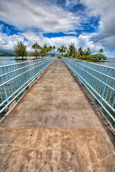 Coconut Island Bridge, Hilo, Hawaii-Something about bridges and HDR photography tend to go together well. This bridge just outside our hotel led to a neat little island full of coconut trees. We ended up getting caught in a huge rainstorm that had us running for the rest area for shelter. Not uncommon for the leeward side of the Big Island of Hawaii. In fact, being from Arizona we get so little rain, that we welcomed all the rain we could get. Nothing beats sitting out on a porch during a summer rain.