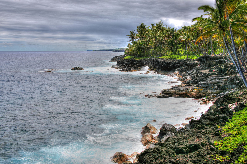 Puna Coast at Sunset, Big Island, Hawaii<br /> Volcanic rock seashores on the leeward side of the Big Island of Hawaii are rugged and hard to maneuver when you're carrying a tripod and photo gear. One fall and you're pretty busted up, especially wearing sandals. But the beauty pulls you in, and all you can think about is finding a scenic vantage point and then wait for the right moment to capture this memorable place. When you're there, you never want to leave. When you're gone, all you think about, is when can I come back.