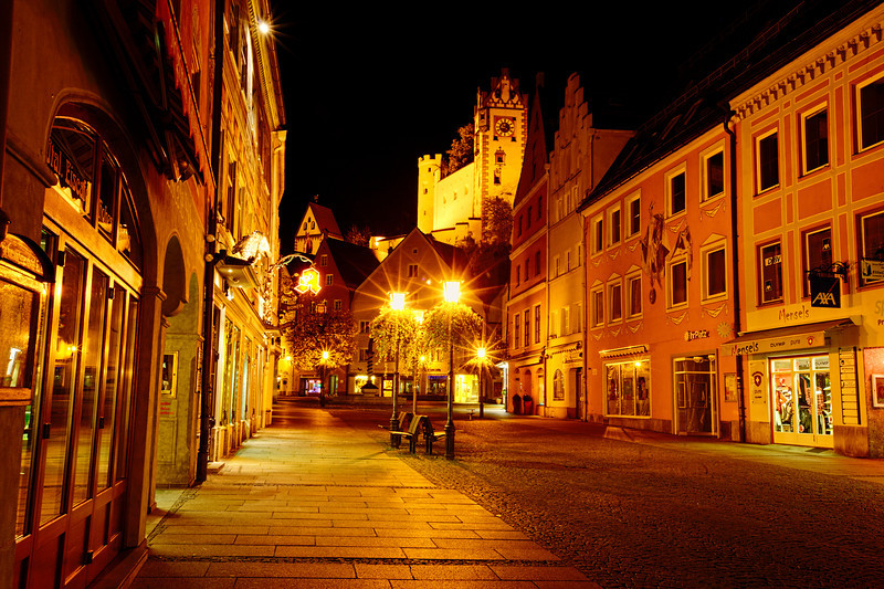 Lamp Lights of Fussen, Germany<br /> It was definitely a cold night out roaming around Fussen. We had just spent the day visiting Neuschwanstein Castle and decided to spend the night down the hill in Fussen. Not many folks were out. I was the only one taking pictures. Kind of felt like I had the town to myself. Gave me time to relax and not feel rushed about having people in the way. This shot was taken of one of the major shopping streets in town. Best part was a full moon, but I'll show those another time.