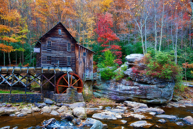 Glade Creek Grist Mill-Revisit in West Virginia<br /> I had to go and try it again this past fall, ahead of a trip to Germany. I had heard the changing leaves in North Carolina and West Virginina were exceptional and that was my cue. Nothing is more fun than crawling up some wooded back road, not knowing what's up around the next bend. The county roads go on forever. Getting lost was part of the experience, where GPS was a waste of time. The Grist Mill happens to be the most photographed spot in West Virgina. Something out of a Kinkade painting. I'm sure he made many trips here in the fall. There is no better time to come.