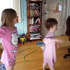 Lila and Mason following a Junior Jazzercise routine on the TV.