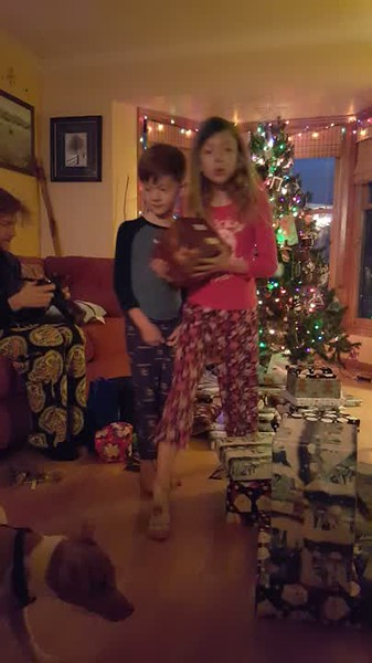 Passing out presents, always the job of the youngest ones in the house.