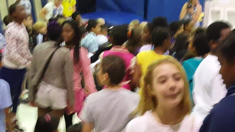 End of the school year party. Lila was standing by Maizy. Mason was by Damare.