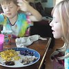 Trying purple and gold food.<br /> Lila age 8; Mason age 5.