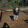 Harrison loves the swing but then he saw a doggie walking behind mommy.