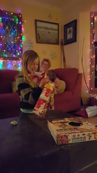 Lila opening presents, 2015, from cousins Iris & Elsa.