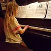 Poppy taught her a song on the piano. No lessons before this. Age 9.5.