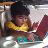 Playing/Reading/Eating with Cheerios book .. thanks to Subbu mam and Vara Athai