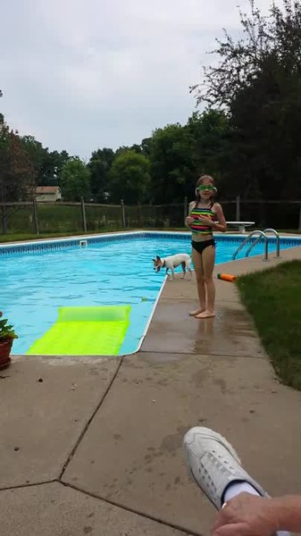 Swimming at Nana's house (with Lola). Age 8.