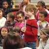 Mason's solo, school concert, age 6, grade 1.<br /> <br /> Love how when he's done, everyone else sings and he just goes back to sit and listen. Sitting next to his best friend, Henry.