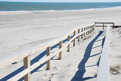 Sand covered walkway to the beach