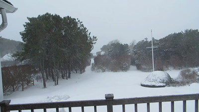 Short video from deck - snow is swirling and you can't see the beach!