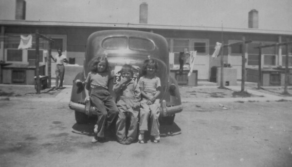 Carol, George and Cherry Burgin with Elmer standing in the background. Photo taken in Cheyenne, Wyoming 1946