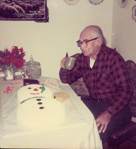 Ed Polka at 82 with snow man cake 12-11-76