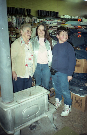 Cecilia Krystyniak Buckner with Cherry and Jake Smock warming up at Buckner General Merchandise store. New Waverly, Texas January 19, 1991