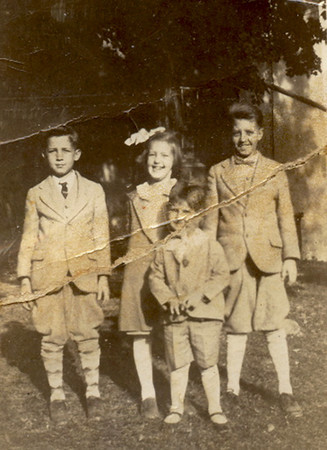 L to R:  Hunsberger siblings- Harold, Kathryn, Willard (in front) & Grandpa Earl (R)  - c.1930?