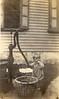 Grandpa Earl at the water pump! (c. 1920)