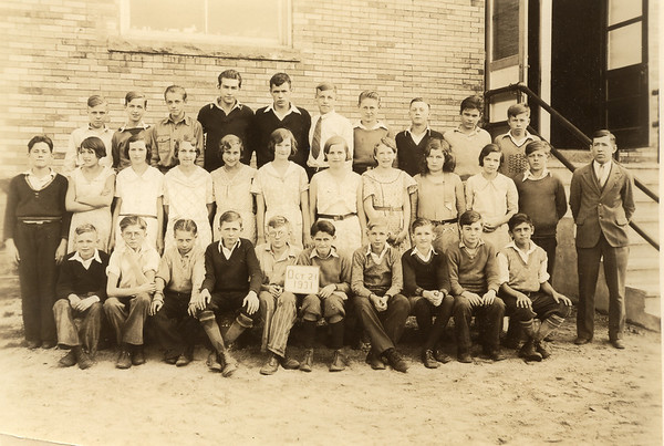 "School Photo from 1931-- Grandma Ruth (nee Yoder) Hunsberger's Father (Oscar Yoder) is on the right; he's the teacher. Oscar also became the principal in the Paint school district. Oscar was born on April 19 1898 in Johnstown PA. He married: Alice Marie HERSHBERGER on Sept. 20 1921 in Johnstown, Cambria, PA, and died at the young age of 35 yrs. (of heart trouble) on Nov. 26 1933 in Geistown, PA. He was buried in Weaver Mennonite Cemetery. Oscar and his wife Alice had 3 daughters: Fern, Ruth (our grandma) and Loretta A. (""Toppy"")."